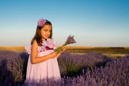 scent: Little girl in a field of lavender - selective focus, copy space Stock Photo