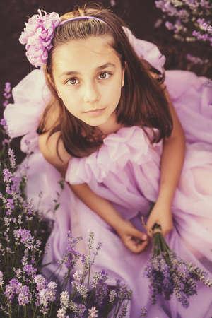 lavanda: Little girl in a field of lavender - selective focus, copy space Stock Photo