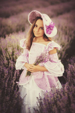 little girl dressed as a princess in a field of lavender