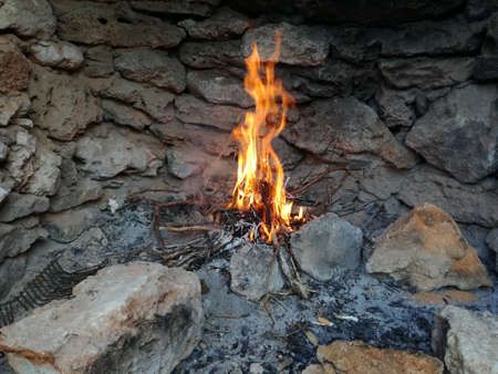 stone fireplace: Fire in a stone fireplace - selective focus, copy space