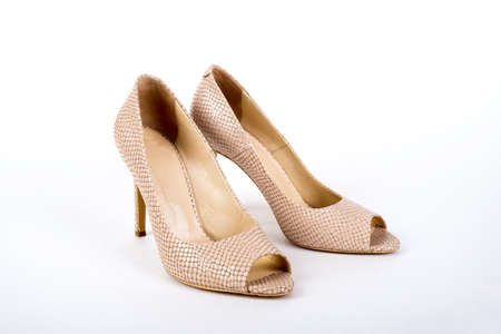 beige elegant ladies high-heeled shoes on a white background