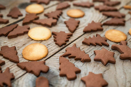 christmas gingerbread cookies with different shapes over a vintage wooden table stock photo 83339033 - Christmas Gingerbread