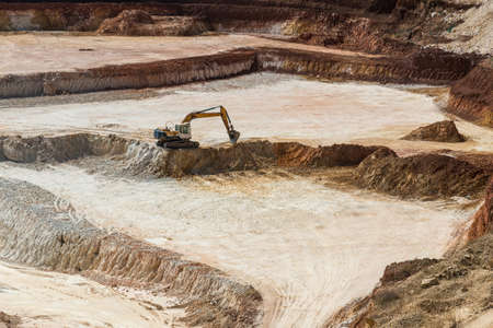 Extraction of clay refractory in the clay quarry Stock Photo