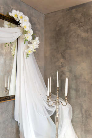 wedding vintage decor with veils, candles and orchids - vertical orientation 스톡 콘텐츠