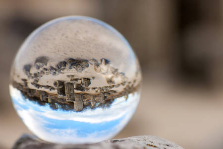 Upside down landscape of Pobiti Kamani, The Stone Forest Natural Reserve near Varna in Bulgaria, Eastern Europe - reflection in a lens ball - selective focus, space for text