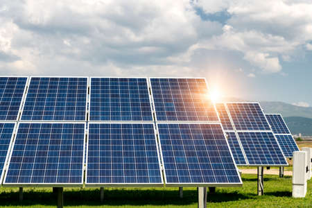 Solar panels, photovoltaics, alternative electricity source - concept of sustainable resources Stock Photo