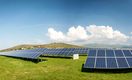 Panoramic view of solar panels, photovoltaics, alternative electricity source - concept of sustainable resources Stock Photo