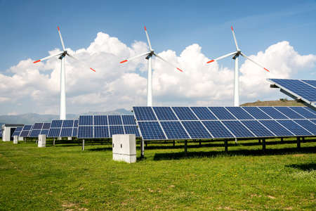 Photo collage of solar panels and wind turbins - concept of sustainable resources - Image