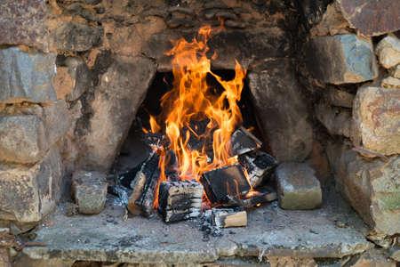 Stone masonry furnace with  burning fire