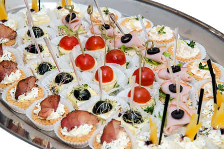 catering food, mini canapes, snacks and appetizers, food for the event - selective focus Stock Photo