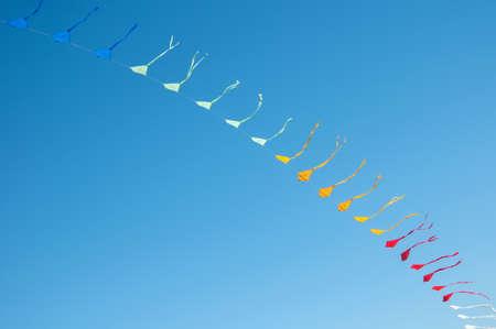 Colorful kites flying in blue sky Stockfoto