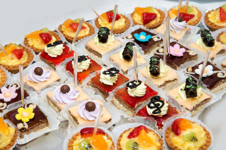 assortment of colorful petit fours for event or wedding reception  - selective focus Reklamní fotografie
