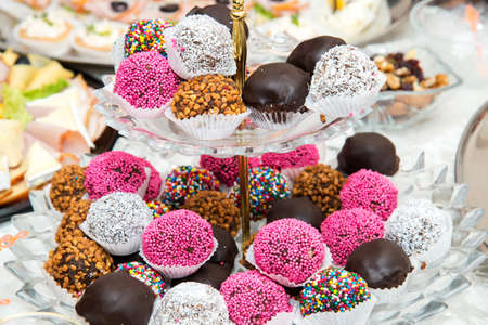 assortment of colorful petit fours for event or wedding reception  - selective focus Stockfoto