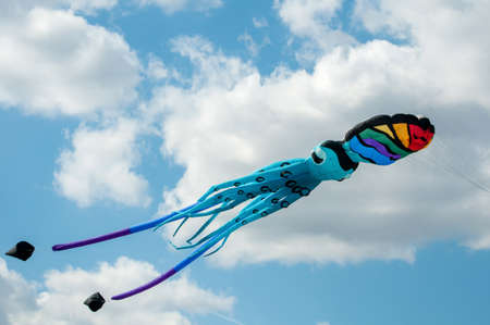Colorful octopus kites flying in blue sky Stockfoto