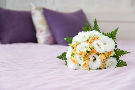 Wedding bouquet for bride on the bed - selective focus, copy space