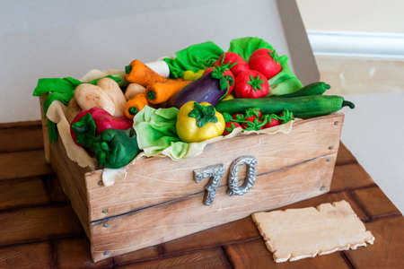 Anniversary cake shaped like a crate with vegetables - top view