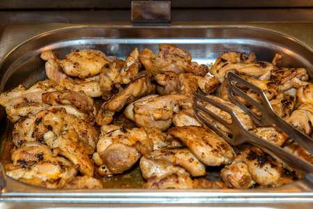 Roasted chicken seasoned slices over a tray 版權商用圖片