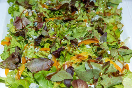 closeup of salad made of different kinds of lettuce and blue cheese