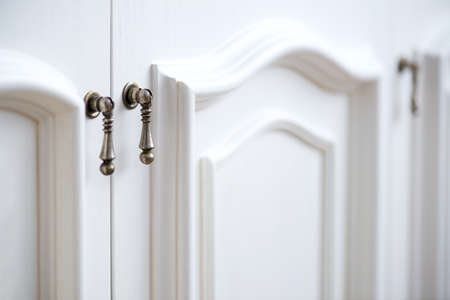 Detail of vintage white cabinet - selective focus, copy space 免版税图像