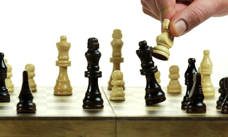 Chess board with chess pieces on white background photo