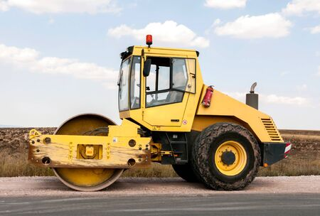 bagger: Support activities for the construction of a highway  Road under construction