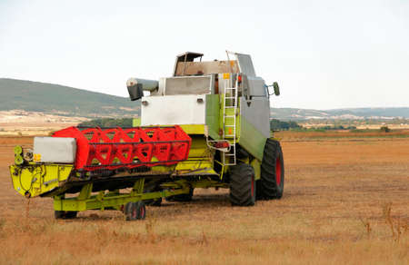 combine harvester: Agricultural activities, modern farm equipment in field
