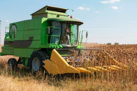 outside machines: Agricultural activities, modern farm equipment in field