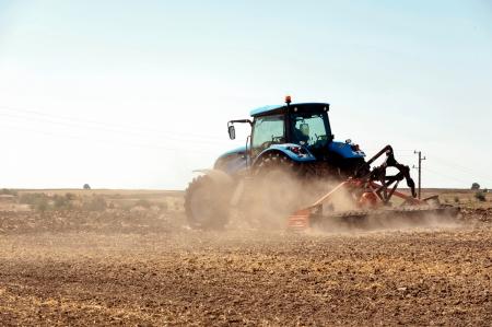 farm equipment: Agricultural activities, modern farm equipment in field