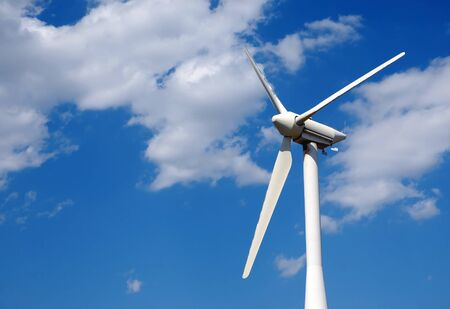 wind up: Wind turbine on a field, close up