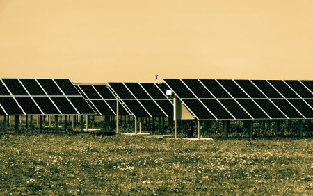 pv: Solar Panels (PV) on the field in rows Stock Photo