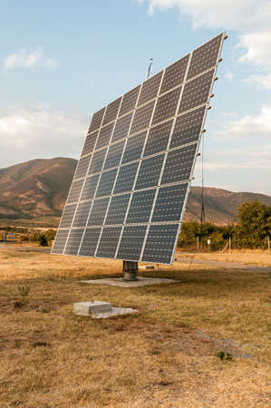 Solar panels at the foot of the mountain photo