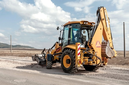 asphalting: Support activities for the construction of roads and highways. Road under construction. Stock Photo