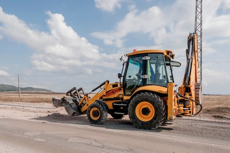 construction vehicle: Support activities for the construction of roads and highways. Road under construction. Stock Photo