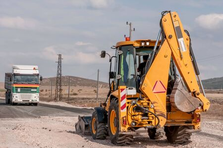 Support activities for the construction of roads and highways. Road under construction. Stock Photo - 15775348