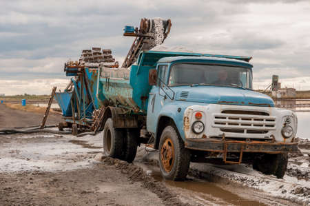 Piles of salt. Extraction and transportation of raw salt. Stock Photo