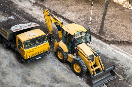 roller compactor: Support activities for the construction of roads and highways. Road under construction. Stock Photo