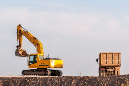 bagger: Support activities for the construction of roads and highways. Road under construction. Stock Photo