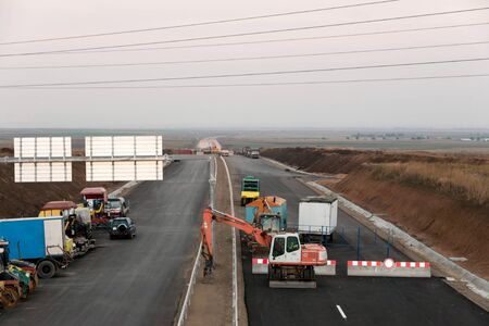 Support activities for the construction of roads and highways. Road under construction. Editorial