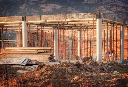 Construction site - scaffolding, bricks, cement