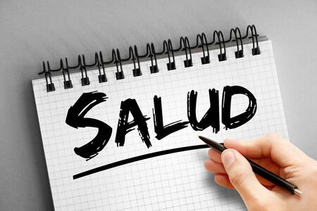 Text note - Salud (Health in Spanish), concept on notepad