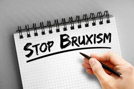 Text note - Stop Bruxism, health concept on notepad