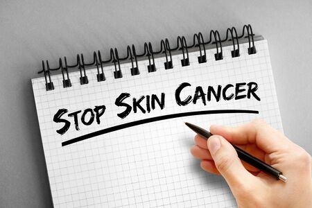Text note - Stop Skin Cancer, health concept on notepad