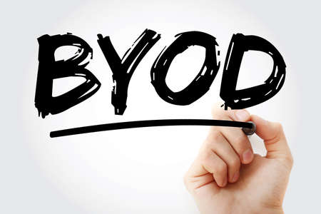 BYOD - Bring Your Own Device acronym with marker, technology concept background