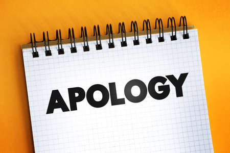 Apology text quote on notepad, concept background
