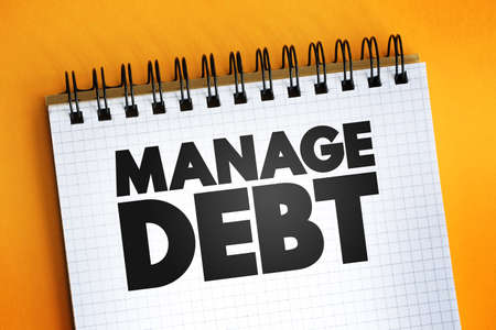 Manage Debt text quote on notepad, concept background