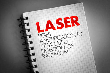 LASER - Light Amplification by Stimulated Emission of Radiation acronym on notepad, technology concept background