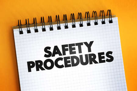 Safety Procedures text quote on notepad, concept background Reklamní fotografie