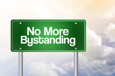 savagery: No More Bystanding Green Road Sign Stock Photo