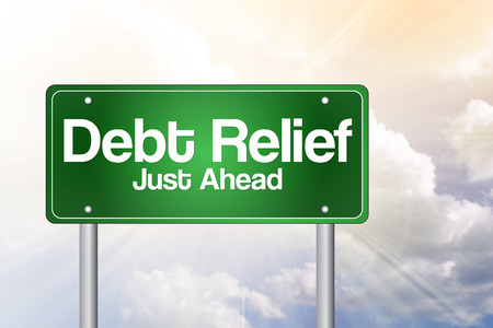 just ahead: Debt Relief, Just Ahead Green Road Sign, business concept Stock Photo