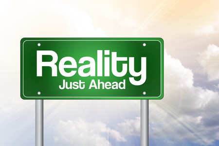 crux: Reality Green Road Sign, business concept Stock Photo